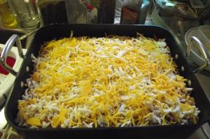 Do another noodle layer, with sauce, then cover with good layer of motz and cheddar